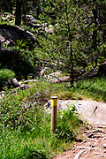 trail marker at Colomers Lakes in the catalan Pyrenees, Spain. Part of the Parc Nacional d'Aigüestortes i Estany de Sant Maurici