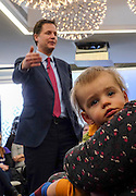 © Licensed to London News Pictures. 25/03/2015. London, UK Penny Foreman listens to Nick Clegg speak. One year old Julian Foreman-Byrne with his mother Deputy Prime Minister and leader of the Liberal Democrats Nick Clegg takes part in a Mumsnet question and answer session at 30 Eutson Square. Photo credit : Stephen Simpson/LNP