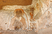 The remains of ancient Buddhist art are photographed on the walls of the caves inside the Buddhas of Bamyanís archaeological site. The Buddhas of Bamiyan were two 6th century monumental statues of standing Buddhas carved into the side of a cliff in the Bamiyan valley in the Hazarajat region of central Afghanistan, situated 230 km northwest of Kabul at an altitude of 2500 meters. The statues represented the classic blended style of Gandhara art. The main bodies were hewn directly from the sandstone cliffs, but details were modelled in mud mixed with straw, coated with stucco. Amid widespread international condemnation, the smaller statues (55 and 39 meters respectively) were intentionally dynamited and destroyed in 2001 by the Taliban because they believed them to be un-Islamic idols. Once a stopping point along the Silk Road between China and the Middle East, researchers think Bamiyan was the site of monasteries housing as many as 5,000 monks during its peak as a Buddhist centre in the 6th and 7th centuries. It is now a UNESCO Heritage Site since 2003. Archaeologists from various countries across the world have been engaged in preservation, general maintenance around the site and renovation. Professor Tarzi, a notable An Afghan-born archaeologist from France, and a teacher in Strasbourg University, has been searching for a legendary 300m Sleeping Buddha statue in various sites between the original standing ones, as documented in the old account of a renowned Chinese scholar, Xuanzang, visiting the area in the 7th century. Professor Tarzi worked on projects to restore the other Bamiyan Buddhas in the late 1970s and has spent most of his career researching the existence of the missing giant Buddha in the valley.