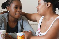 Upset teenage girl with mother. Cleared for Mental Health issues.