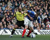 Photo: Lee Earle.<br /> Portsmouth v Manchester City. The Barclays Premiership. 11/03/2006. City's Trevor Sinclair (L) battles with Brian Priske.