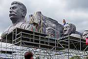 "A man filming on top of Stalin's replica head. For a TV movie called ""Monstrum"" produced by the Czech Television a huge replica of Soviet dictator Joseph Stalin was installed at metronome in the Czech capital. From May 1, 1955, until it was destroyed at the end of 1962  a giant granite statue of Stalin with a line of workers and scientists behind him was standing exactly at the same place."