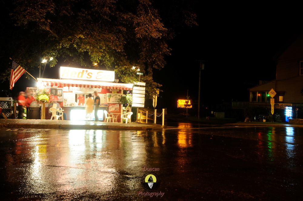 7/3/11 -- WISCASSET, Maine. Red's Eats, a Maine fixture at all times of day and night, draws folks even in the rain and the night . Photo by Roger S. Duncan.