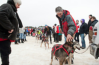 Keith Bryar gives his dogs a little love after finishing first in the Open Class race of the 82nd annual Laconia World Championship Dog Sled race Sunday afternoon.  (Karen Bobotas/for the Laconia Daily Sun)