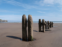Old wooden groynes on the beach at Sandsend, Whitby.