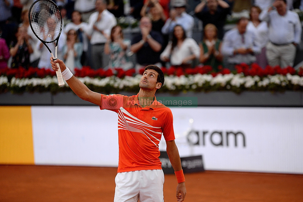 May 12, 2019 - Madrid, Spain - Novak Đoković of Croatia celebrates after defeating Stefanos Tsitsipas of Greece in the Madrid Open final during day nine of the Mutua Madrid Open at La Caja Magica in Madrid on 12nd May, 2019. (Credit Image: © Juan Carlos Lucas/NurPhoto via ZUMA Press)