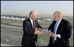 The Mayor of London Boris Johnson talks to Tim Clark the President of Emirates Airline at the Emirates HQ in Dubai, The Mayor is on a 2 day tour of the UAE, Monday April 15, 2013. Photo By Andrew Parsons / i-Images