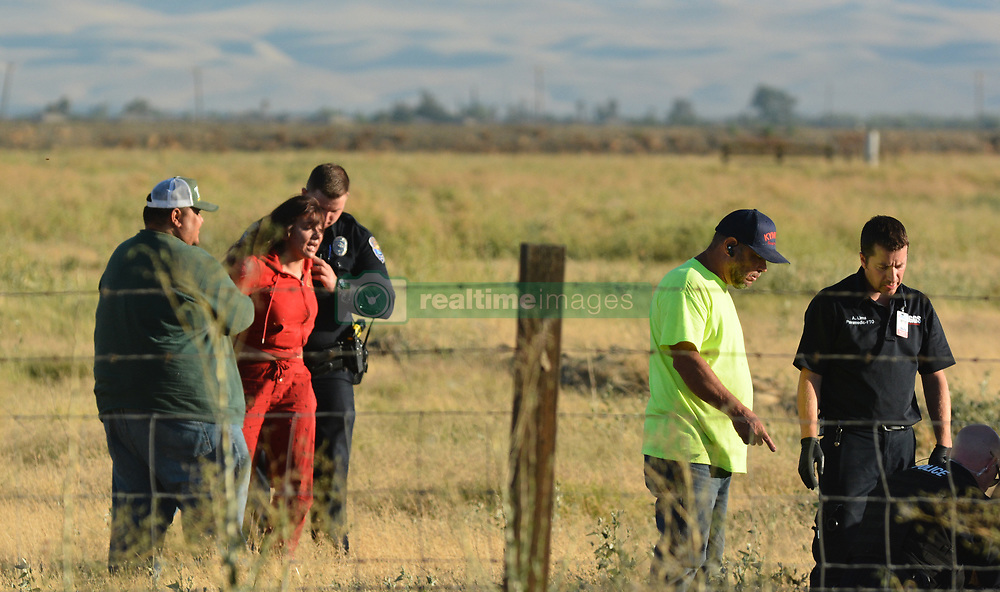 California Highway Patrol and a coroner from the Merced County Sheriff's Department check on the body of 14-year-old Jacqueline Sanchez of Stockton on Friday, July 21, 2017, off Henry Miller Road east of Mercey Springs Road. Sanchez was identified by the Merced County Coroner's Office Saturday as the victim of a fatal crash.