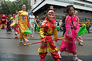 Chinese monkey mask boy during the opening parade for the Birmingham Weekender Arts And Culture Festival on 23rd September 2017 in Birmingham, United Kingdom.