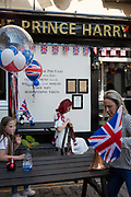 Flags and balloons outside the Prince Harry pub in the old town of Windsor as it gets ready for the royal wedding between Prince Harry and his American fiance Meghan Markle, on 14th May 2018, in London, England.
