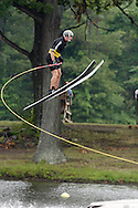 Monroe, NY  - A water ski jumper flies through the air during a competition at Twins Lakes Water Ski Park on July 28, 2008.