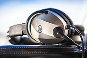 Lightspeed noise-cancelling headset atop the panel of a TBM700 turboprop aircraft.  <br />