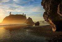 Warm light illuminates off shore mist and sea stacks on Ruby Beach, Olympic National Park, Washington