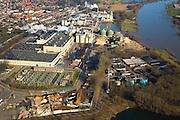 Nederland, Gelderland, Renkum, 11-02-2008; industrieel complex aan de Neder-Rijn: papierfabriek van Norske Skog, voorheen Parenco, enige producent van krantenpapier in Nederland; de grondstof bestaat uit houtpulp (zaagsel) wordt ivm explosiegevaar nat gehouden; de fabriek heeft eigen trafo-station voor aanvoer elektriciteit van het landelijke net en waterzuiverinsinstallatie; neder rijn, nederrijn, papierfabriek, papierfabricage, papierproducent, papier, grondstoffen, hout, bomen..luchtfoto (toeslag); aerial photo (additional fee required); .foto Siebe Swart / photo Siebe Swart