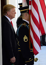 United States President Donald J. Trump awaits the arrival of King Abdullah II and Queen Rania of Jordan to the White House in Washington, DC on Wednesday, April 5, 2017.<br /> Credit: Ron Sachs / CNP *** Please Use Credit from Credit Field ***