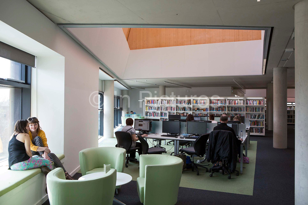 Members of the public inside The Hive, Worcester, UK. The first fully integrated university and public library in the UK. It also houses the county archives and archaeology service, the local history centre and local authority hub. The building is low energy.
