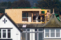 Tops off working at a house near the Alfred Dunhill Links Championship this morning at Championship Course at Carnoustie.