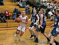 Laconia's Meghan Gaspa looks for a shot guarded by Merrimack Valley's Jadyn Holmes and Abby Grandmaison during NHIAA Division III basketball Wednesday evening.  (Karen Bobotas/for the Laconia Daily Sun)