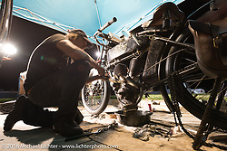 Jon Szalay of New Jersey working on his 1913 Thor during the rest day in Dodge City during the Motorcycle Cannonball Race of the Century. Stage-8 from Wichita, KS to Dodge City, KS. USA. Saturday September 17, 2016. Photography ©2016 Michael Lichter.
