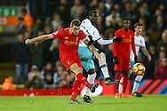 Jordan Henderson of Liverpool passes the ball under pressure from Pedro Mba Obiang of West Ham United. Premier League match, Liverpool v West Ham Utd at the Anfield stadium in Liverpool, Merseyside on Sunday 11th December 2016.<br /> pic by Chris Stading, Andrew Orchard sports photography.