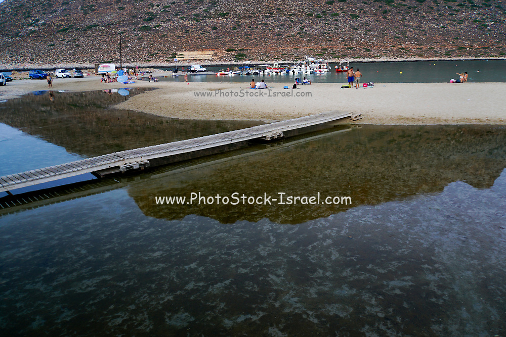 Unidentifiable tourists relaxing on a beach in Chania, Crete, Greece