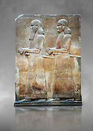Stone relief sculptured panel of two functionaries. Room 811. Inv AO 19876 from Dur Sharrukin the palace of Assyrian king Sargon II at Khorsabad, 713-706 BC.  Louvre Museum Room 4 , Paris .<br /> <br /> If you prefer to buy from our ALAMY PHOTO LIBRARY  Collection visit : https://www.alamy.com/portfolio/paul-williams-funkystock/ancient-assyria-antiquities.html  Refine search by adding background colour, place, subject, museum etc into the LOWER SEARCH WITHIN GALLERY box to <br /> <br /> Visit our ANCIENT ASSYRIAN PHOTO COLLECTIONS for more photos to download or buy as wall art prints https://funkystock.photoshelter.com/gallery-collection/Ancient-Assyrian-Art-Artefacts-Antiquities-Historic-Sites-Pictures-Images-of/C0000cjRqQyJjLag