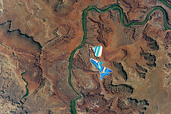 Aug 9, 2017 - Moab, Utah, U.S. - An astronaut aboard the International Space Station took this photograph of solar evaporation ponds outside the city of Moab, Utah. There are 23 colorful ponds spread across 400 acres. They are part of a large operation to mine potassium chlorid, more commonly referred to as muriate of potash (MOP), from ore buried underground. MOP is in high demand as fertilizer because there are no easy substitutes for potassium, an essential nutrient for plant growth. (Credit Image: © NASA/ZUMA Wire/ZUMAPRESS.com)