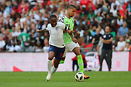 Nigeria Tyronne Ebuehi (21) tackling England Raheem Sterling (10) during the Friendly International match between England and Nigeria at Wembley Stadium, London, England on 2 June 2018. Picture by Matthew Redman.