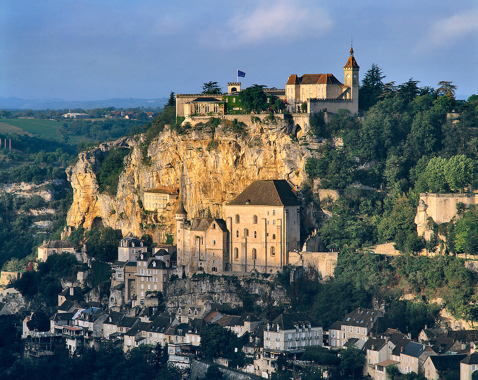Sunrise awakens the pilgrimage village of Rocamadour on the Alzou River in France.