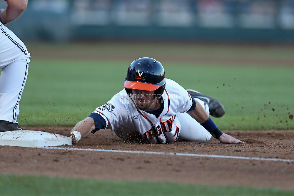 Branden Cogswell #7 of the Virginia Cavaliers dives back into first base during Game 4 of the 2014 Men's College World Series between the Virginia Cavaliers and Ole Miss Rebels at TD Ameritrade Park on June 15, 2014 in Omaha, Nebraska. (Brace Hemmelgarn)