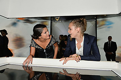 Left to right, SELENA GOMEZ and CARA DELEVINGNE at the Louis Vuitton Series 3 VIP Launch held at 180 Strand, London on 20th September 2015.