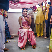 The alternative to the traditional turmeric (haldi ceremoy) at a Kashmiri Pundit wedding is a cold, white yogurt that is poured on the bride to purify her skin.