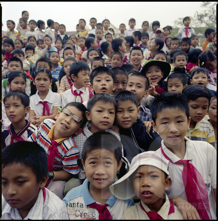 Primary school children at morning assembly in Vinh, Vietnam, Asia