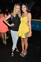 Left to right, BECKY TONG and LAUREN MILLS at a summer party hosted by Jo Wood & Yasmin Mills at Boujis, 43 Thurloe Street, London on 9th July 2014.