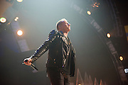 Macklemore performing at the iHeartRadio Music Festival in Las Vegas, Nevada on Sepembter 20, 2014.