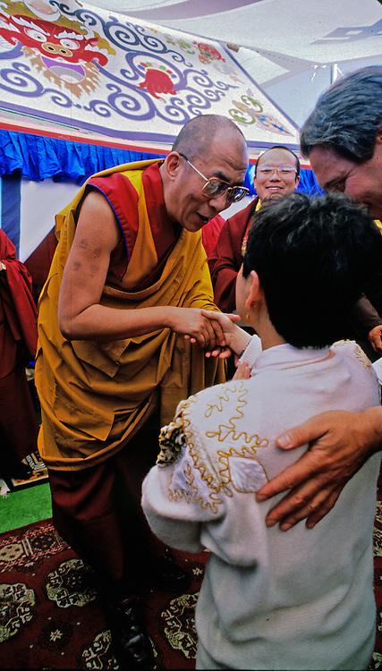 The Dalai Lama greets special guests following ceremonies honoring him atop Mt. Tamalpais near San Francisco, California.