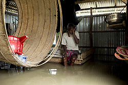 August 16, 2017 - Bogra, Bangladesh - ABDUL KUDUS sits in the floodwater  in the Manikdi area at Bogra. The death toll has risen to 30 people dead in the last three days across the country. (Credit Image: © K M Asad via ZUMA Wire)