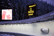 A bobsled during a World Cup practice at the Whistler Sliding Centre, a sports venue for the 2010 Vancouver Winter Olympics, Whistler, British Columbia, Canada.