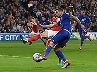 Football - 2017 / 2018 Sky Bet Championship - Cardiff City vs. Nottingham Forest<br /> <br /> Joe Ralls of Cardiff City crosses the ball challenged by Tobias Figueiredo of Nottingham Forest, at Cardiff City Stadium.<br /> <br /> COLORSPORT/WINSTON BYNORTH