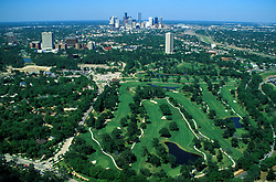 Stock photo of an aerial view of downtown Houston skyline and the Hermann Park golf course during daytime