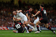 England's Mike Tindall (c) is tackled by Rhys Priestland (10) of Wales. Wales v England, international rugby, World cup warm up match at Millennium Stadium in Cardiff on Sat 13th August 2011. Pic By Andrew Orchard, Andrew Orchard sports photography,