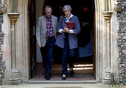 Prime Minister Theresa May and her husband Philip arrive to attend a service at St Andrew's Church in Sonning, Berkshire.