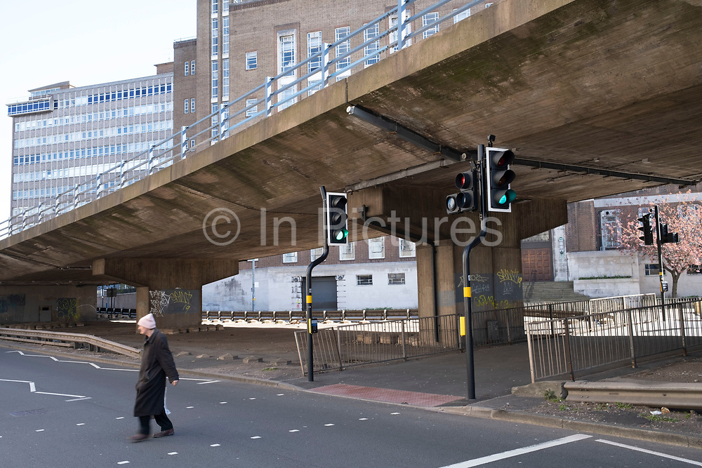 Local atmosphere due to Coronavirus lockdown is felt on a street by street level as streets remain deserted in on St Chads Queensway leading to Aston Expressway as people observe the stay at home advice from the government on 7th April 2020 in Birmingham, England, United Kingdom. This area of main roads through central Birmingham is normally full of cars, but is currently eerily empty of vehicles. Coronavirus or Covid-19 is a new respiratory illness that has not previously been seen in humans. While much or Europe has been placed into lockdown, the UK government has announced more stringent rules as part of their long term strategy, and in particular social distancing.