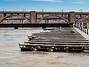 29 MARCH 2019 - ST. PAUL, MN: A marina closed because the Mississippi River is above flood stage in St. Paul. The Mississippi River through the Twin Cities has already hit flood stage. Several roads and parks in St Paul are already closed in anticipation of higher flood levels. Weather forecasters and hydrologists have backed off a little on earlier predictions of severe flooding because the snow melt has been slower than expected.       PHOTO BY JACK KURTZ