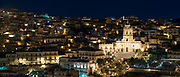 Floodlit buildings in ancient hill city of Modica Alta famous for its Baroque architecture, South East Sicily
