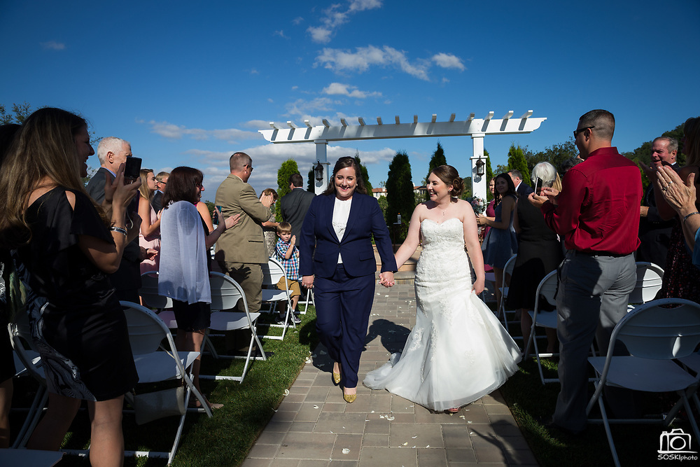 Brides celebrate their wedding with family and friends at Wedgewood Eagle Ridge in Gilroy, California, on June 9, 2017. (Stan Olszewski/SOSKIphoto)