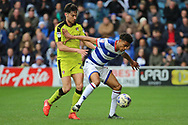 Rotherham United midfielder Joe Newell (22) battles for possession with Queens Park Rangers defender Darnell Furlong (29) during the EFL Sky Bet Championship match between Queens Park Rangers and Rotherham United at the Loftus Road Stadium, London, England on 18 March 2017. Photo by Matthew Redman.