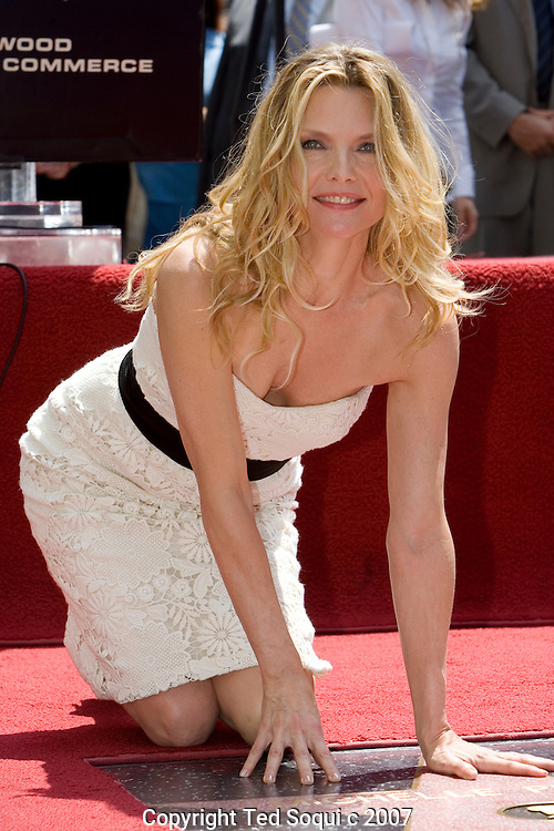"""Michelle Pfeiffer honored with star on the Hollywood Walk Of Fame. This was the 2,345 Star on the Hollywood Walk Of Fame. .Michelle starred in """"Scarface"""", """"Love Field"""", """"The Fabulous Baker Boys"""", and Frankie and Johnny."""" .Jeff Bridges and Paul Rudd were also there to honor her..Hollywood and Highland Complex, Hollywood, CA"""