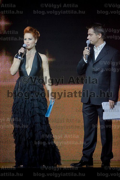 Barbara Orosz and Levente Harsanyi are seen as the hosts of the Miss Plastic Hungary 2009 beauty contest for beauties with surgically enhanced bodies, Budapest, Hungary. Saturday, 10. October 2009. ATTILA VOLGYI