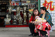 SHAOSHAN, CHINA - 4 NOVEMBER 2005 - Shop owners wait by the road for tourists to buy statues and other souvenirs in Mao's childhood village of Shaoshan. Shaoshan has become a money spinning attraction that symbolizes one of the great contradictions of the politics of the ruling Communist Party of China. Photo by Natalie Behring